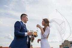 Happy gorgeous bride and stylish groom with true emotions on the roof Stock Photos