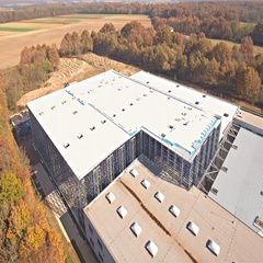 Drone ascending over warehouse zooming out 4K Stock Footage