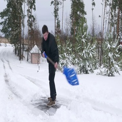 Man clears snow in the yard Stock Footage