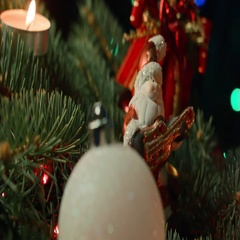 Toy Santa on the Christmas tree with Christmas balls and candle Stock Footage