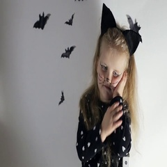 Little girl in black cat costume Stock Footage