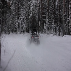ATV riding in the snow Stock Footage