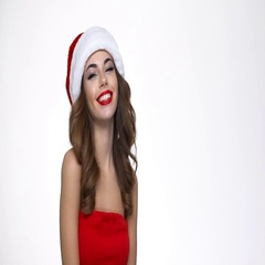 Woman in red christmas costume looking at camera Stock Footage