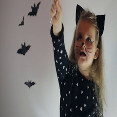 Young girl in cat Halloween costume Stock Footage