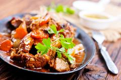 Fried meat with spice on the pan Stock Photos