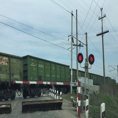 Cargo Freight train rides on the move with a red traffic light. Stock Footage