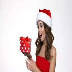 Excited young woman in santa claus costume opening gift box  Stock Footage