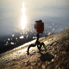 Action camera on small tripod on shore Stock Footage