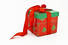Red and green Christmas gift with ribbon isolated. Stock Photos
