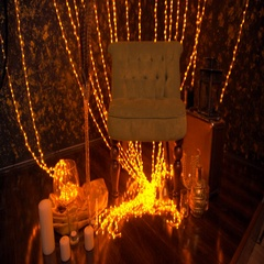 Dark wall and floor decorated with yellow christmas lights. Stock Footage