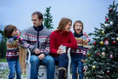 Beautiful happy family of four, having fun outdoors in the snow around the Chris Stock Photos