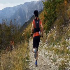 Young woman skyrunner with walking sticks running from hill on a mountain trail Stock Footage