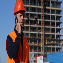 Engineer Man Holding Cell Talk with Smart Telephone Modern Building Architecture Stock Footage