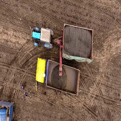 Aerial shot of harvester unloading sunflower seeds in truck. Top view. 4K Stock Footage