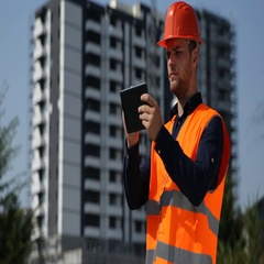 Engineer Man Hold Using Digital Tablet Under Development Site Building Structure Stock Footage