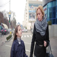 Mother and daughter walking on the street. cold autumn Stock Footage