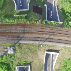 Two road tunnel which takes traffic from above railway tracks Stock Footage