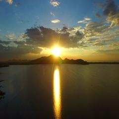 Sun set sky over water reservoir Stock Footage