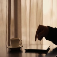 Man Using Tablet PC and Drinking Coffee in Cafe Stock Footage