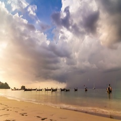 Timelapse of sunset over the sea with boats at the Phuket Island, Thailand Stock Footage