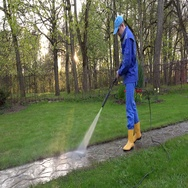 Professional male worker wash footpath with high pressure water jet Stock Footage