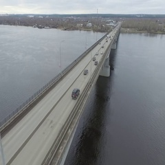 Traffic on the bridge on the Kama River. Autumn, aerial. Stock Footage