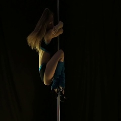 Hot young woman in sexy lingerie performs sensual pole dance. Go-go dancer in Stock Footage