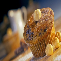 Covering a muffin with icing sugar. Stock Footage