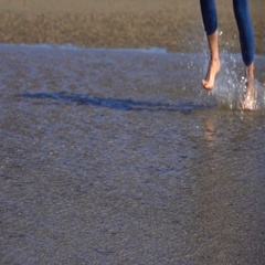 Girl Running in Water on a Beach, Slow Motion Stock Footage