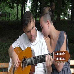 Man and woman playing guitar Stock Footage