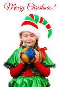 Girl Santa's elf with Christmas ball over white Stock Photos