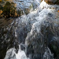 The Creek runs over the rocks closeup Stock Footage