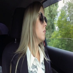 Beautiful young blond woman drives car stock footage video Stock Footage