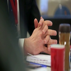 Hands of a businessman at the negotiation table close-up. Stock Footage
