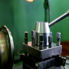 Turning metal blank on a lathe. Turning of metal parts Stock Footage