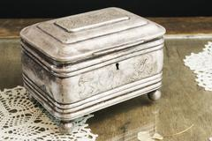 Silver Casket, jewelry/trinket box on retro table Stock Photos