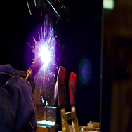Closeup view of welder at work in factory Stock Footage