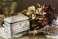 Silver Casket, jewelry/trinket box with dry roses and lavender Stock Photos