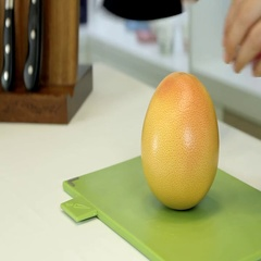 To cut a grapefruit Stock Footage
