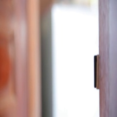 Men's hand closes and lock the brass door knobs Stock Footage