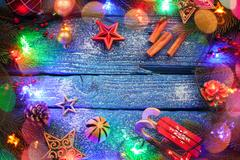 Christmas border with balls, stars and decoration on blue wooden background Stock Photos