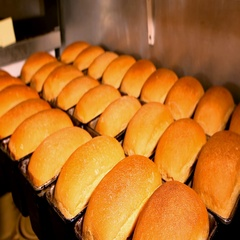 Baker puts freshly baked bread on the shelves. Selling bread Stock Footage