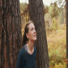 Romantic girl walks through the forest dreams with pleasant and smiles. Autumn Stock Footage