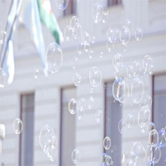 Soap bubbles flying around people in city 4K Stock Footage