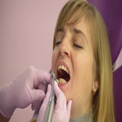 Woman at the dental hygienist and dentist clinic Stock Footage