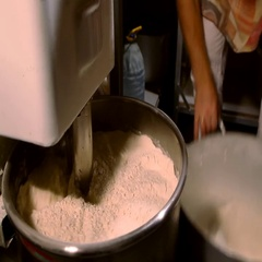 Bread Mixer In Bakery, mixing dough for baguettes in a bakery machine for mixing Stock Footage
