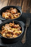 Potatoes baked with sausage and bacon Stock Photos