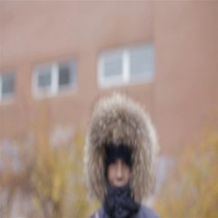 Portrait of a boy in winter jacket with hood on his head Stock Footage