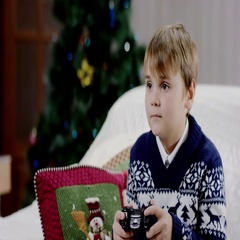 A young boy plays a video game on his playstation Stock Footage