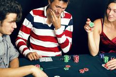 Young people playing poker off-line tournament, friends party co Stock Photos